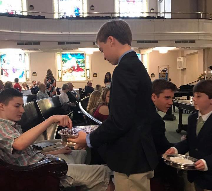 Youth serving in church